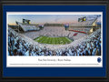 Picture: Penn State Nittany Lions Beaver Stadium 13 X 40 panoramic print professionally double matted in team colors and framed to 18 X 44. This panorama, taken by Christopher Gjevre, captures the excitement of the Penn State Nittany Lion fans as their team scores a touchdown during a sell-out homecoming game that ultimately resulted in a stunning win over Michigan at Beaver Stadium�. Nittany Lion fans showed their Penn State pride and wore white at the game for the all-stadium white out, cheering their team to victory in the fourth overtime. In addition to the Saturday evening football game, homecoming festivities included the annual parade that starts at Beaver Stadium and winds through campus and College Avenue, the first event at the new Pegula Ice Arena, as well as numerous other athletic events throughout the weeken