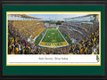 Picture: Baylor Bears McLane Stadium 13 X 40 panoramic print professionally double matted in team colors and framed to 18 X 44. This panorama, taken by James Blakeway, captures the Baylor Bears football team playing its inaugural game at the new McLane Stadium, ending the evening with a 45-0 victory over SMU. The Bears� home opener was completely sold out in record time, as fans hurried to witness Baylor�s first on-campus football game since 1935. Built on a 93-acre site along the Brazos River, the new stadium also serves as a catalyst for business activity and economic development for the City of Waco. Around the site there are tailgating opportunities, as well as an option to take tailgating to the water in the most unique fashion, as fans are now able to boat to Baylor games. The new facility seats 45,145 fans with future expansion possible to 55,000.
