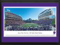 Picture: Kansas State Wildcats Bill Snyder Family Stadium 13 X 40 panoramic print professionally double matted in team colors and framed to 18 X 44. This panorama, taken by James Blakeway, spotlights a mid-season game between two Big 12 Conference teams, the K-State Wildcats and the West Virginia Mountaineers. Adding to the excitement and serving as a backdrop is the recently completed West Stadium Center at Bill Snyder Family Stadium. The 250,000 square-foot west-side stadium expansion features a student-athlete dining hall, the Athletics Hall of Honor, new concessions and restrooms, premium seating, press box, field lighting and other amenities. The first-class facility also serves as the northwest gateway to Kansas State University�s beautiful campus.