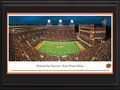 Picture: Oklahoma State Cowboys Boone Pickens Stadium 13 X 40 panoramic print professionally double matted in team colors and framed to 18 X 44. This panorama, taken by James Blakeway, captures the fans cheering as their beloved Oklahoma State Cowboys crush the undefeated Baylor Bears at Boone Pickens Stadium. This evening was a test for both highly ranked teams and one of the nation�s biggest showdowns. In the end, the Cowboys won with a victorious final score of 49-17. OSU fans showed their support with a long-standing tradition of rising to their feet, waving one arm, while singing The Waving Song, �Oklahoma State! Oklahoma State! We'll sing your praise tonight!� Oklahoma State football boasts one of the nation�s top football powers, with a rich bowl history that includes many of the most prestigious games in college football.