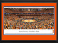 Picture: Syracuse Orange Carrier Dome 13 X 40 panoramic print professionally double matted in team colors and framed to 18 X 44. This panorama, taken by Christopher Gjevre, spotlights the Syracuse Orange playing at the Carrier Dome in a colossal showdown against the Duke Blue Devils. The epic affair featured a thrilling overtime finish in which Syracuse emerged victorious 91-89 and rose to #1 in the nation with the win. The two legendary coaches - Jim Boeheim and Duke's Mike Krzyzewski called it one of the greatest games of all time. The game marked the official tip-off of the Syracuse/Duke rivalry in the ACC. The spectacular event broke the on-campus college basketball attendance record set the prior year, with 35,446 fans packing the largest domed stadium in college sports.