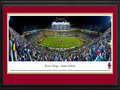 Picture: Boston College Eagles Alumni Stadium 13 X 40 panoramic print professionally double matted in team colors and framed to 18 X 44. This panorama of Alumni Stadium, taken by Christopher Gjevre, captures the action of a Boston College Eagles football game. The roots of Alumni Stadium and on-campus football at Boston College date back to 1915. Years later, after playing at two off-campus sites, the current stadium was built on Boston College's lower campus and opened in 1957. Renovations took place in 1971 and 1998, bringing seating capacity to its current 44,500. The Eagles football team, a member of the Atlantic Coast Conference, began play in 1892 and is consistently ranked among the nation's best for academic achievement and graduation. Boston College was established in 1863 and is located in Chestnut Hill, Massachusetts.
