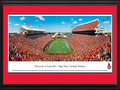 Picture: Louisville Cardinals Papa John's Cardinal Stadium 13 X 40 panoramic print professionally double matted in team colors and framed to 18 X 44. This panorama, taken at the newly remodeled Papa John's Cardinal Stadium by Christopher Gjevre, features the University of Louisville football team playing to a capacity crowd. The $72-million stadium expansion, completed in 2010, increased seating capacity from 42,000 to 55,000 and added 33 suites. The University claims that Papa John's Cardinal Stadium is the only stadium owned and operated by a United States university with all-chairback seating; there are no bleachers in the stadium. Founded in 1798, the University was the first city-owned public university in the United States and currently enrolls over 22,000 students annually.