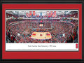 Picture: North Carolina State Wolfpack PNC Arena 13 X 40 panoramic print professionally double matted in team colors and framed to 18 X 44. This panorama, taken by Christopher Gjevre, spotlights an exciting night of men's basketball as the North Carolina State University Wolfpack play for a win against rival, the University of North Carolina Tar Heels, at PNC Arena. Formerly known as the RBC Center, the $158-million PNC Arena opened in 1999, serves as a multi-use home to the North Carolina State University men's basketball program and seats 19,722 fans. The Wolfpack basketball program began in 1911 and continues to have a successful winning history. The action and excitement of ACC basketball in North Carolina is a way of life, with friendly rivalries among Triangle Universities, UNC Chapel Hill and Duke.