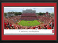 Picture: North Carolina State Wolfpack Carter-Finley Stadium 13 X 40 panoramic print professionally double matted in team colors and framed to 18 X 44. This panorama, taken by James Simmons, captures the action of the NC State Wolfpack playing in front of a sell-out crowd in Carter-Finley Stadium. Athletics at NC State began with football in 1892, a game between students from the North Carolina Agricultural and Mechanical College and the Raleigh Male Academy, on the grounds of what is now Pullen Park. From those humble beginnings, NC State University has been competing at the highest level of college athletics for more than a century, as a charter member of both the Southern Conference and, later, the Atlantic Coast Conference.
