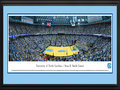 Picture: North Carolina Tar Heels Dean E. Smith Center 13 X 40 panoramic print professionally double matted in team colors and framed to 18 X 44. This panorama of the University of North Carolina men's basketball team, taken by Christopher Gjevre, captures the fan excitement after the Tar Heels make a slam dunk at the Dean E. Smith Center and ultimately defeat their opponent. The arena, commonly referred to as the Dean Dome, seats 21,750 fans and is named after former North Carolina coach Dean Smith, who coached the team from 1961 to 1997. The Tar Heels are one of the most successful programs in NCAA history and, on March 2, 2010, became the second college basketball program to reach 2,000 wins. They are one of only three Division I Men's Basketball programs to have ever achieved 2,000 victories.