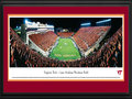 "Picture: Virginia Tech Hokies Lane Stadium 13 X 40 panoramic print professionally double matted in team colors and framed to 18 X 44. This panorama, taken by Christopher Gjevre, features the Virginia Tech Hokies playing their season opener ""Orange Effect"" game at Lane Stadium/Worsham Field. Billed as one of the toughest places in college football for opponents to play, the Hokies have enjoyed more than a decade of success at Lane Stadium/Worsham Field. Their home field advantage was further evidenced, when Virginia Tech won its 100th game at Lane Stadium on September 22, 1994. Today, after additions and renovations, the Stadium seats over 65,000 fans, making it the biggest stadium in the Commonwealth of Virginia. Football at Virginia Tech kicked off their first season in 1892."