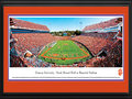 Picture: Clemson Tigers Frank Howard Field at Memorial Stadium 13 X 40 panoramic print professionally double matted in team colors and framed to 18 X 44. This panorama, taken by Robert Pettit, features the Clemson Tigers football team playing on their home turf for another win at Frank Howard Field at Memorial Stadium. On the same day Clemson honored the 1981 National Championship football team at Death Valley, the Tigers tied one of its records for points in a quarter with 35 in the third quarter, and also eclipsed 50 points in the game for a second-straight week. The Tigers were established in 1897 and achieved their first undefeated season in 1900. Clemson University is located in the foothills of the Appalachian Mountains on the shores of Lake Hartwell and enrolls over 19,450 graduate and undergraduate students on an annual basis.