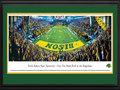 "Picture: North Dakota State Bison Gate City Bank Field at the Fargodome 13 X 40 panoramic print professionally double matted in team colors and framed to 18 X 44. This panorama, taken by James Blakeway, captures a sea of gold as the top-ranked North Dakota State Bison take on Georgia Southern in the battle for a coveted slot in the Division I Football Championship Subdivision title game. This evening's ""Gold Rush"" game was the third meeting and the third thrilling victory for the Bison over the Eagles, with a final score of NDSU 23, Georgia Southern 20. The Bison's on-field success has translated into impassioned fan support, attracting more than 100,000 fans a year and ranking NDSU in the top-10 nationally in the FCS. Fielding their first season in 1894, the Bison play their home games on the artificial turf of Gate City Bank Field at the Fargodome."