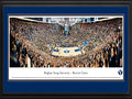 Picture: Brigham Young Cougars Marriott Center 13 X 40 panoramic print professionally double matted in team colors and framed to 18 X 44. This panorama, taken by James Blakeway, provides a snapshot of the excitement as the BYU Cougars defeat their co-conference opponent. This is only the third time these two teams have met in play and, the first time ever at the Marriott Center. This is a matchup that many BYU fans looked forward to, including thousands of BYU students. Despite the not-so-warm weather during basketball season in Provo, students camped outside the Marriott Center in hopes of snagging front row seating. The Marriott Center was named in honor of benefactor J. Willard Marriott, founder of the Marriott Corporation. BYU fielded its first basketball team in 1903.