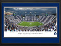 Picture: Brigham Young Cougars LaVell Edwards Stadium 13 X 40 panoramic print professionally double matted in team colors and framed to 18 X 44. This panorama of LaVell Edwards Stadium was taken by Robert Pettit. It spotlights the Brigham Young Cougars playing against Georgia Tech, an ACC opponent. The game was the grand finale of events throughout BYU Homecoming week, including a spectacular win for the Cougars. The game was also a sectional striped game, where fans sitting in odd sections are asked to wear dark blue and fans sitting in even sections are asked to wear white. The True Blue Foam tradition, one of the most popular Homecoming activities among students, was also a part of the weeks� events, when students converge on Helaman Fields to show their spirit while diving, sliding and dancing into a sea of blue foam.