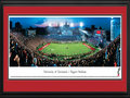Picture: Cincinnati Bearcats Nippert Stadium 13 X 40 panoramic print professionally double matted in team colors and framed to 18 X 44. This panorama captures the Cincinnati Bearcats playing a thrilling night game against a conference opponent in Nippert Stadium. This game marks the beginning of the University's 125th football season, which began when football was organized by Arch Carson in 1885. In 1901, Carson guided construction of the field, which is still called Carson Field. Nippert Stadium has been home to Bearcats football since 1902, making it the fourth-oldest playing site and fifth-oldest stadium in college football. It was named in honor of Jimmy Nippert, who died of injuries sustained in a game in 1923. Jimmy's grandfather, James Gamble of Procter and Gamble, provided funds to complete construction of the Stadium in 1924.