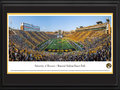 Picture: 2014 Missouri Tigers original 13 X 40 Memorial Stadium/Faurot Field panoramic print professionally double matted in team colors and framed to 18 X 44. This panorama, taken by Robert Pettit, features the Missouri Tigers football team facing the Vanderbilt Commodores in an inner-conference match-up at Faurot Field. The Tigers victory added to Mizzou�s Homecoming celebration, a tradition that started over 100 years ago. Known as the birthplace of Homecoming, it all began in 1911 when former athletic director Chester Brewer, called for alumni to �come home� for the annual football game versus KU. Today, Mizzou Homecoming has grown into one of the largest student-run celebrations of its kind and was recently named the best Homecoming in the nation. The University of Missouri was founded in Columbia, Missouri, in 1839.