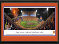 "Picture: Just out from October 3, 2015 is a panoramic poster professionally double matted and framed to 18 X 44 of Clemson's 24-22 National TV win over #6 Notre Dame on ABC! This panorama of Frank Howard Field at Memorial Stadium, taken by James Blakeway, spotlights the excitement after a rain-soaked football match-up between two collegiate powerhouses, the Clemson University Tigers and Notre Dame. Despite the rain, Clemson fans packed Death Valley with orange ponchos and rain boots to cheer the Tigers to victory. The trademark Clemson colors are brilliantly on display, as Tiger fans ""Gather at The Paw� following a big win."