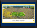 Picture: Just out as the Jim Harbaugh era begins for the Michigan Wolverines in Ann Arbor, Michigan with a 35-7 trouncing of Oregon State on September 12, 2015! Michigan Wolverines Michigan Stadium panoramic poster professionally double matted in team colors and framed to 18 X 44. This panorama, taken by James Blakeway, captures the University of Michigan Wolverines in their home opener against the Oregon State University Beavers. It marks the first home game for J. Ira and Nicki Harris Family Head Football Coach Jim Harbaugh. The game also kicks off a year-long celebration of Michigan Athletics' 150th Anniversary. The Michigan Wolverines intercollegiate competition officially began its rich and storied tradition in the season of 1865-66 and, since that time, the athletic teams have claimed many national championships, beginning with football�s 1901 national title.