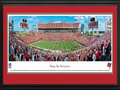 "Picture: This 13.5 X 40 panorama of the Tampa Bay Buccaneers playing at Raymond James Stadium is professionally double matted in team colors and framed to 18 X 44. Raymond James Stadium has been home to the Tampa Bay Buccaneers since 1998. It boasts a number of unique features including a pirate ship that comes to life after the Buccaneers score a field goal or touchdown. The club's nickname, ""Buccaneers,"" is a reference to the pirate legends of Southwest Florida. The Buccaneers are the first NFL franchise to have won the Super Bowl after losing at home on the opening day of the season. From the NFL Stadiums collection."
