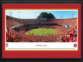 Picture: This 13.5 X 40 panorama of Candlestick Park, the previous home of the San Francisco 49ers, has been professionally double matted and framed to 18 X 44. It captures the excitement of a touchdown play and ultimate victory over a fierce co-conference opponent. As the first major league professional sports franchise to be based in San Francisco, the 49ers were part of the All-American Football Conference until merging with the NFL in 1950. Between 1988 and 1990, the 49ers set an amazing league record with 18 consecutive road victories. The 49ers were also the first NFL franchise to win back-to-back Super Bowls under different head coaches. From the NFL Stadiums collection.