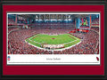 Picture: This 13.5 X 40 panorama has been professionally double matted in team colors and framed to 18 X 44. It features the Arizona Cardinals playing at University of Phoenix Stadium. After playing 18 years at Sun Devil Stadium, the Arizona Cardinals finally had a stadium to call their own when University of Phoenix Stadium opened with much fanfare in 2006. With its exterior skin representing the indigenous barrel cactus, it was the first stadium built in North America with both a retractable roof and a retractable field. The field weighs 18.9 million pounds and is moved in only for game days. The Cardinals are the oldest existing professional football club in the United States and are a charter member of the National Football League. From the NFL Stadiums collection.