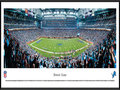 Picture: This panorama of the Detroit Lions NFL football team playing at Ford Field has been professionally framed to 13.75 X 40.25. The team started in 1929 as the Portsmouth Spartans, joined the NFL in 1930 and became the Detroit Lions in 1934. The Lions played at the University of Detroit Stadium for four years and then moved to Briggs Stadium (later named Tiger Stadium) in 1938. In 1975, the Lions moved to the Pontiac Silverdome, where they played until moving to Ford Field in 2002. The Lions' history includes NFL Championships, several enshrinees in the Pro Football Hall of Fame and one of America's best holiday traditions � Detroit's annual Thanksgiving Day Classic. From the NFL Stadiums collection.