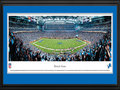 Picture: This 13.5 X 40 panorama of the Detroit Lions NFL football team playing at Ford Field has been professionally double matted in team colors and framed to 18 X 44. The team started in 1929 as the Portsmouth Spartans, joined the NFL in 1930 and became the Detroit Lions in 1934. The Lions played at the University of Detroit Stadium for four years and then moved to Briggs Stadium (later named Tiger Stadium) in 1938. In 1975, the Lions moved to the Pontiac Silverdome, where they played until moving to Ford Field in 2002. The Lions' history includes NFL Championships, several enshrinees in the Pro Football Hall of Fame and one of America's best holiday traditions � Detroit's annual Thanksgiving Day Classic. From the NFL Stadiums collection.
