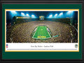 Picture: This 13.5 X 40 panorama has been professionally double matted in team colors and framed to 18 X 44. It highlights the Green Bay Packers playing a victorious Sunday night game at the historic Lambeau Field. The Packers home field was dedicated as City Stadium on September 29, 1957, and renamed Lambeau Field in 1965 in tribute to Curly Lambeau. In 2007, the Packers celebrated the 50th anniversary of the opening of Lambeau Field. The Green Bay Packers have won more championships than any other team in the National Football League. The Super Bowl trophy, awarded each year to the winning team of the the NFL's championship game, was renamed in 1970 in memory of Vince Lombardi, legendary head coach of the Green Bay Packers. From the NFL Stadiums collection.