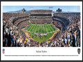 Picture: This panoramic has been professionally framed to 13.75 X 40.25. It underscores the on-field action of the Oakland Raiders playing to their home crowd at Oakland-Alameda County Coliseum. The Raiders began play in 1960, as a charter member of the American Football League (AFL), and joined the National Football League (NFL) in 1970. In the ensuing five decades, the Raiders have won an AFL Championship; won four AFC Championships; participated in five Super Bowls, winning three Super Bowls; and won or tied for seventeen division titles. The Raiders are the only club in the NFL to play in at least one Super Bowl in the 1960s, 1970s, 1980s, and 2000s. From the NFL Stadiums collection.