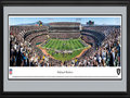 Picture: This 13.5 X 40 panoramic has been professionally double matted in team colors and framed to 18 X 44. It underscores the on-field action of the Oakland Raiders playing to their home crowd at Oakland-Alameda County Coliseum. The Raiders began play in 1960, as a charter member of the American Football League (AFL), and joined the National Football League (NFL) in 1970. In the ensuing five decades, the Raiders have won an AFL Championship; won four AFC Championships; participated in five Super Bowls, winning three Super Bowls; and won or tied for seventeen division titles. The Raiders are the only club in the NFL to play in at least one Super Bowl in the 1960s, 1970s, 1980s, and 2000s. From the NFL Stadiums collection.
