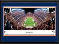 "Picture: This 13.5 X 40 panorama of the Denver Broncos playing at Invesco Field has been professionally double matted in team colors and framed to 18 X 44. The club reached the NFL's pinnacle by capturing its first World Championship in Super Bowl XXXII. Since 1960 the Denver Broncos have grown into a team that is followed by legions of fans throughout the Rocky Mountain region. The Broncos popularity has translated into several home game traditions, and one such tradition is called the ""Incomplete Chant."" It begins when the opposing team throws an incomplete pass, the stadium announcer then broadcasts the incomplete pass, the fans complete the chant by saying ""in-com-plete,"" and the process ends with the sound effect of the ""sad trombone."" From the NFL Stadiums collection."