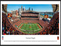 Picture: This panorama has been professionally framed to 13.75 X 40.25. It captures the Cincinnati Bengals as they host the Seattle Seahawks at Paul Brown Stadium, located on the north bank of the Ohio River. While members of the modern era American Football League, the Bengals played at Nippert Stadium on the campus of the University of Cincinnati from 1968-69. When the AFL merged with the NFL in 1970, the team moved into a new venue called Riverfront Stadium (later renamed Cinergy Field), which also was situated on Cincinnati�s downtown riverfront. They played there for 30 seasons from 1970-99. Paul Brown Stadium, which opened in 2000, is named after Bengals founder and Pro Football Hall of Famer Paul Brown. From the NFL Stadiums collection.