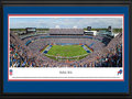 Picture: This 13.5 X 40 panorama has been professionally double matted in team colors and framed to 18 X 44. It captures the excitement as the Buffalo Bills hosted their longtime division rival, the Miami Dolphins, in their home opener at the newly renovated Ralph Wilson Stadium. In the first game after the passing of the Bills founding owner, Ralph C. Wilson, Jr., in the stadium that bears his name, Wilson was honored in a special pregame ceremony. The Bills went on to win the game in front of a sellout crowd by a score of 29-10, a memorable day in their rich history that includes two consecutive AFL Championships in 1964 and 1965, and four consecutive Super Bowl appearances from 1990 to 1994. From the NFL Stadiums collection.
