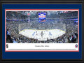 Picture: This 13.5 X 40 panorama has been professionally double matted in team colors and framed to 18 X 44. It spotlights one of the NHL�s youngest teams, the Columbus Blue Jackets, playing against the Pittsburgh Penguins on their home ice in Columbus, Ohio. It all began in June 1997, when the National Hockey League awarded the city of Columbus an expansion franchise that would later be named the Blue Jackets. Just over three years later, on October 7, 2000, the club played its inaugural game before a sellout crowd of 18,136 fans. The name �Blue Jackets� was chosen to celebrate the patriotism, pride and rich Civil War history of the state of Ohio and the city of Columbus. The Blue Jackets play their home games at Nationwide Arena in downtown Columbus, which opened in 2000.