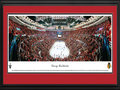 Picture: This 13.5 X 40 panorama of the Chicago Blackhawks during the team's Western Conference Quarterfinals series, clinching Game 5, with a win over the Minnesota Wild has been professionally double matted in team colors and framed to 18 X 44. The Blackhawks captured the 2013 Presidents' Trophy after posting a National Hockey League leading 77 points during the regular season. Chicago's fifth consecutive Stanley Cup Playoffs berth started with a five-game series win over the Wild. The Blackhawks' 5-1 victory in Game 5 was witnessed by 21,597 fans at the United Center, marking the franchise's 217th consecutive capacity crowd dating back to 2008.