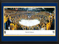 Picture: This 13.5 X 40 panorama has been professionally double matted in team colors and framed to 18 X 44. It captures the Nashville Predators celebrating their Western Conference Quarterfinal victory over the Detroit Red Wings in Game 5. The Predators won the series 4-1, capping a season in which they finished ahead of their National Hockey League Central Division rival for the first time. They also beat the Red Wings for the first time in their third playoff series. The Predators made it even sweeter by handing the Red Wings their earliest postseason departure since a six-game first-round loss to Edmonton in 2006. In Nashville tradition, the fans tossed catfish on the ice in celebration at Bridgestone Arena.