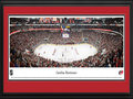 Picture: This 13.5 X 40 panorama has been professionally double matted in team colors and framed to 18 X 44. It spotlights the Carolina Hurricanes playing at the PNC Arena in Raleigh, North Carolina. The franchise originally joined the National Hockey League in 1979, and the Hurricanes were established in 1997, after relocating from Hartford, Connecticut, to North Carolina. Since arriving in North Carolina, the Hurricanes have captured numerous division titles and Eastern Conference championships and, in 2006, they brought North Carolina its first major professional sports championship, capturing the coveted Stanley Cup. The Hurricanes also hosted the NHL All-Star Game in January 2011, with an estimated 138,000 fans taking part in the weekend's festivities.
