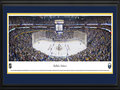 Picture: This 13.5 X 40 panorama of the First Niagara Center has been professionally double matted in team colors and framed. It spotlights a thrilling night of ice hockey as the Buffalo Sabres kicked off their season on home ice. Their unique moniker, chosen by a �name the team� contest, was selected to reflect a weapon carried by a leader, one that can be used effectively in both an offensive and defensive moment, much like the necessary components of a successful hockey club. The Buffalo, New York team has undergone many transitions since their inception into the National Hockey League in 1970. Personnel and ownership movement has been reflected in changes to the logo and team colors, which today is a stylized bison atop two crossed sabres in blue, white and gold.