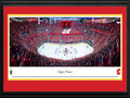 Picture: This 13.5 X 40 -panorama has been professionally double matted in Calgary Flames team colors and framed to 18 X 44. It features the Calgary Flames battling on home ice against the Anaheim Ducks in Round Two of the National Hockey League Stanley Cup Playoffs. Honoring a tradition that started in Calgary in 1986, Calgary Flames fans come dressed in red and proudly fill the arena collectively forming the �C of Red� on game nights to show their support. The Flames were founded in 1972 in Atlanta Georgia and moved to Calgary in 1980. Through their charitable arm, the Flames Foundation for Life, the Flames have injected over $30 million into southern Alberta in support of health and wellness, education and grassroots and amateur sports.