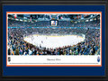 "Picture: This 13.5 X 40 panorama has been professionally double matted in Edmonton Oilers team colors and framed to 18 X 44. It brings to focus the Edmonton Oilers playing on home ice. The Oilers, based in Edmonton, the capital of the Canadian province of Alberta, had their team name inspired by Alberta's vast oil reserves. A group of talented players were introduced to the NHL when the Oilers joined the league in 1979. After winning multiple Stanley Cup Championships during the 1980s, the Oilers were honored with ""dynasty"" status by the Hockey Hall of Fame. In the 1983-84 season, the Oilers finished first overall in the National Hockey League winning a franchise record of 57 games and scoring a grand total of 446 goals for an NHL record."