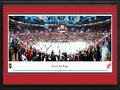 Picture: This 13.5 X 40 panorama of the Detroit Red Wings in the opening game of the 2011 Stanley Cup Playoffs has been professionally double matted in team colors and framed to 18 X 44. This contest marked the Red Wings 20th consecutive season in the playoffs. One of the Original Six teams of the National Hockey League, the Red Wings were established in 1926. Winning their first Stanley Cup Championship in 1936, they repeated the feat the following year, becoming the first American team to win consecutive Stanley Cup Championships. As of 2011, the Red Wings have won more Stanley Cup Championships than any other NHL franchise based in the United States.