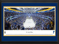 Picture: This 13.5 X 40 panorama captures the St. Louis Blues scoring a goal on home ice at the Scottrade Center and has been professionally double matted in team colors and framed to 18 X 44. In this National Hockey League Western Conference Quarterfinals series game, the Blues were pitted against the defending Stanley Cup Champions, the Los Angeles Kings. The Blues won the first matchup of this series, with all five games decided by one goal and one of those games going into overtime. This is the third all-time playoff encounter between the Kings and the Blues. The success of the St. Louis Blues speaks for itself, as they reached the Stanley Cup Final in each of their first three seasons and reached the playoffs in 25 consecutive seasons.