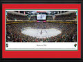 Picture: This 13.5 X 40 panorama captures the action of the Minnesota Wild playing on home ice to a capacity crowd at Xcel Energy Center and has been professionally double matted in team colors and framed to 18 X 44. On June 25, 1997, the National Hockey League announced that Minnesota had been awarded an expansion franchise to begin play in the 2000-2001 season. The club name, the result of a fan write-in campaign, reflects Minnesota�s natural beauty and wildlife. The Wild crest is a pictogram that depicts both the Minnesota Wilderness and the silhouette of a wild animal. Among the components hidden in the logo are the North Star, evergreen trees, a red sky, the sun and/or moon and a stream. The organization retired sweater number 1, as a tribute to Wild Fans, on October 11, 2000.
