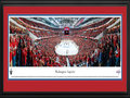 Picture: This 13.5 X 40 panorama of the Verizon Center has been professionally double matted in Washington Capitals team colors and framed to 18 X 44. It spotlights the Washington Capitals in Game 2, as they defeat the New York Rangers 1-0 in overtime, to take a 2-0 series lead in the National Hockey League Eastern Conference Quarterfinal series. The Capitals held firm when they were a man down, then went on to make the winning goal in overtime. A razor-thin margin in the playoffs between these teams is typical, as five of their seven games in the last year's postseason were decided by one goal, including three games that went into overtime play. This is the third consecutive season that the Rangers have faced the Capitals in the playoffs, and the fourth time in the past five seasons.
