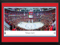 Picture: This 13.5 X 40 panorama of the Washington Capitals playing at the Verizon Center has been professionally double matted in team colors and framed to 18 X 44. It features the Capitals in the National Hockey League Stanley Cup Playoffs in Game 4 of the Eastern Conference Semifinals versus the New York Rangers. It is a marquee matchup and one that fans have become accustomed to seeing in the Playoffs. This was a night to remember, as the Capitals defeated the Rangers behind a game-winning goal 24 seconds into the third period, resulting in a 3-1 series lead