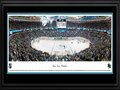 Picture: This 13.5 X 40 panorama of the San Jose Sharks at the Shark Tank has been professionally double matted in team colors and framed to 18 X 44. The Sharks joined the National Hockey League in 1991 and have become one of the league�s most successful franchises, on and off the ice. The team made history in 1994, compiling the largest single-season turnaround in NHL history, finishing with 82 points, a 58-point jump from the previous season. That year, they also earned their first Stanley Cup Playoff series victory when the No. 8 seeded Sharks defeated the Presidents� Trophy-winning Detroit Red Wings, another NHL first. The Sharks are famous for their pre-game entrance to the ice when the players skate out through a 17-foot tall shark mouth with fog pouring out and eyes flashing red.