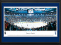 Picture: This 13.5 X 40 panorama of the Rogers Arena has been professionally double matted in Vancouver Canucks team colors and framed to 18 X 44. It captures the Vancouver Canucks in mid-game action. Vancouver's hockey roots go deep beginning with their first professional team in 1911, the Vancouver Millionaires, followed by a number of minor league teams before the Canucks joined the National Hockey League as an expansion team in 1970. The Canucks history includes advancement to the Stanley Cup Final, numerous division titles and a Presidents' Trophy. On March 27, 2011, the team recorded its 50th victory of the season for the first time in franchise history.