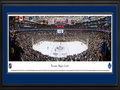 Picture: This 13.5 X 40 panorama of the Air Canada Centre has been professionally double matted in Toronto Maple Leafs team colors and framed to 18 X 44. It captures one of the most physical rivalries in the National Hockey League, a tradition that occurs four times a season, as the Toronto Maple Leafs face off against the Philadelphia Flyers. The Toronto franchise was established in 1917 and has been one of the most popular teams in the NHL. They have captured over a dozen Stanley Cup Championships and sent more players to the Hall of Fame than any other team. The club is one of the Original Six members of the NHL and was renamed the Maple Leafs on Valentine's Day 1927. The Air Canada Centre opened in 1999; that season the Maple Leafs defeated the Philadelphia Flyers in the first Playoff series ever staged in their new home.