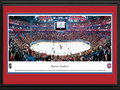 Picture: This 13.5 X 40 panorama of the Montreal Canadiens playing on home ice has been professionally double matted in team colors and framed to 18 X 44. Established in 1909, the Canadiens are the longest continuously operating professional ice hockey team, as well as one of the oldest sports franchises in North America. They are the only existing National Hockey League club to predate the founding of the NHL in 1917, and are one of the Original Six teams that composed the NHL for 25 seasons (1942-1967). As of 2011, the Canadiens were still by far the NHL's most successful club, having won a record 24 Stanley Cup Championships since its inception.