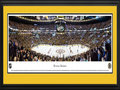 Picture: This 13.5 X 40 panorama has been professionally double matted in Boston Bruins colors and framed to 18 X 44. It features an exciting night of hockey as the Boston Bruins kicked off their season. The Bruins have enjoyed one of the most esteemed histories in the National Hockey League. Long considered to be strictly a Canadian sport, the Boston Bruins became the first American franchise to join the League in October of 1924. The club adopted the distinctive black and gold team colors as early as the 1930s, but it wasn�t until 1948 that the now well-recognized spoked �B� logo appeared on their jerseys. Today, the Bruins boast one of the most enthusiastic fan bases in sports. Their home arena, TD Garden, hosts a capacity of 17,565 on game day.